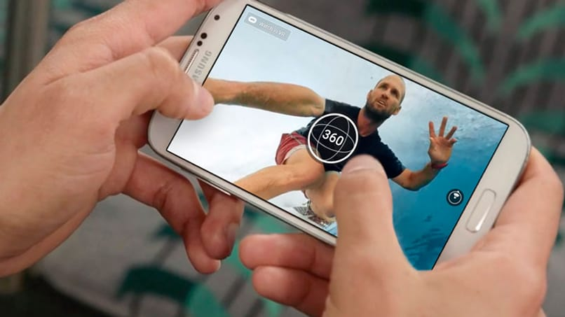 person watching 360 degree videos on cell phone